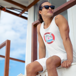 Tank_mens_white_full logo_man sitting in window