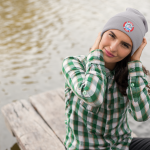 beanie on girl by water