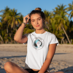 tee-mockup-of-a-bronzed-woman-sitting-by-palm-trees-at-the-beach-26802