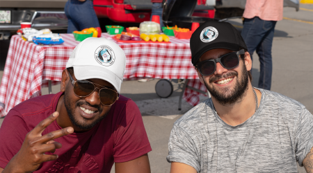 trucker-hat-mockup-of-two-men-tailgating-29876